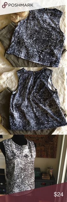 ✨Zara Sleeveless Black and White Splatter Top✨ 100% Polyester  Bust: 38 inches  Length: 22 inches  Super cool black and white paint splatter multimedia sleeveless top from Zara. The front is thicker than the back, which is like a soft t-shirt material. EUC. As always, comment with any questions!! Zara Tops