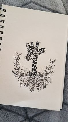 Giraffe flower tattoo