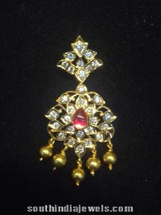 Traditional pendant studded with polki diamonds, ruby and adorned with gold…