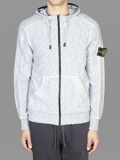 Stone Island hooded sweater with front zip fastening and two open pockets #stoneisland