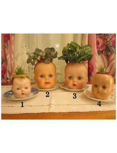 Vintage Doll Head Planters by ramshacklerascals on Etsy, $22.50...Bought a doll today at a thrift shop for this project - I felt terrible about ripping off the poor baby's head!  Any ideas for the leftover body parts?