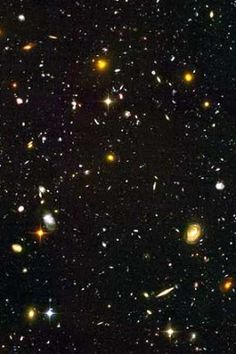 A miscellany of stars and galaxies - sadly, you won't see this with the naked eye or binoculars! Some of the stars are a few light years distant. The galaxies are millions of light years distant