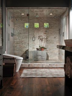 Luxury means being able to do yoga poses in your shower — at least for one of designer Susan Fredman's clients. She delivered not only a large space but also a dramatic boulder rock for seating. Earth tones, textured tiles, natural light and a steam shower complete this soothing, masculine space.