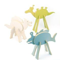 Topozoo - Custom Creature Playset - Monsters by Geared For Imagination - Toys. $18.55. From the Manufacturer                What is Topozoo?  Is it a puzzle?  A building system? Room Décor?  Craft Project?  Play set? Topozoo (meaning 'layered animals') are unique wooden custom creature playsets that are designed, manufactured and shipped here in the USA from recycled wood, finished with water based, non-toxic stains and packaged in recycled craftboard boxes.  T...