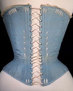 Corset (back view): 1864, possibly English or French silk stiffened with whalebone. Museum no. T.169-1961