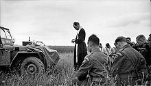 Battle for Caen - A priest and soldiers from the 11th Armoured Division pray before the attack on Eterville july 10, 1944