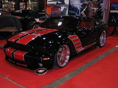 Mustang Black with red stripes. Cars Speed HotRod
