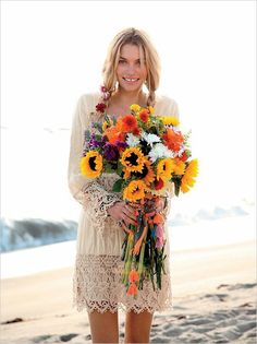 In a beach-perfect mini-dress. | 36 Of The Most Effortlessly Beautiful Boho Wedding Dresses Ever