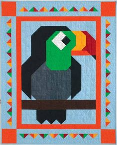 Playful Patch Quilt Kit: A friendly toucan has joined the family of QM Patch Pals. Made mostly from squares and half-square triangles, this easy kid's quilt is sure to please your favorite little person.