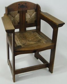 Burstow and Hewett : An Arts & Crafts oak and ebony inlaid armchair designed : Online Auction Catalogue