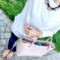 IG @mrscasual <click through to shop this look> loft two in one white sweater. Jcrew toothpick dark denim skinny jeans. Emery bow flats. Tory burch York buckle tote. Kendra Scott. Statement necklace. Michael kors Lexington watch.