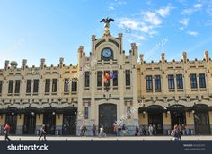 stock-photo-valencia-spain-march-people-pass-by-the-train-station-in-valencia-the-third-major-402582370.jpg (1500×1096)