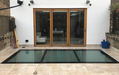 Walk on glass for the garden and also skylight for a new basement. Glass Roof Extension, Walking On Glass, Underground Homes, Glass Partition, Shower Screen, Glass Bathroom, Skylight, Walk On, Basement