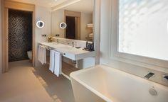 PORCELANOSA Grupo Projects: The 'soulful' refurbishment of the Hotel Don Pancho in Benidorm, Alicante Alicante, Office Bathroom, Solid Surface, Bathroom Interior Design, Corner Bathtub, Sink, Projects, Refurbishment, Bathroom Vanities