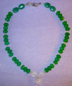 This stylish holistic necklace made of Green Jade faceted beads with Rock Crystal Shamrock and spacers, is a wonderful  Christmas gift. In addition to its festive appearance, Rock/Quartz Crystal promotes clarity of thought, enhances and purifies the spiritual, mental, and physical energy.  Green Jad...