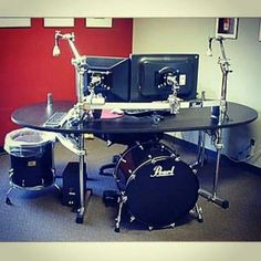 And now for something completely different - Stick the kick drum computer case under this drum kit desk - you can add a cymbal to one of the stand and use it as a desk lamp with the bulb placed under the cymbal.