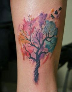 Beautiful watercolor tattoo if a tree in autumn. Changing of the seasons. Let go of your past.
