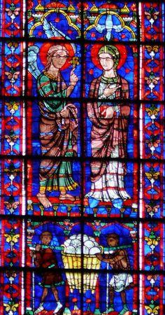 vitral   Arte Catedral de Chartres. Vitral en el eje superior del coro. Parte inferior: encima de los panaderos, los donantes del vitral, la Anunciación y la Visitación