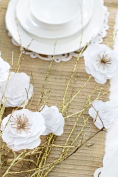 Paper Flower Centerpiece - This is a really inexpensive craft that looks gorgeous as a centerpiece for any occasion. Perfect for holidays, weddings, etc. Click for tutorial