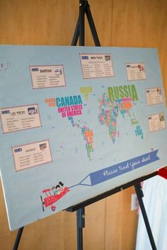Creative escort card idea, but I don't know why they have a map of the whole world if the table names are all famous cities in the US only. To be more accurate and consistent, either just have a map of the US or have the table names be famous cities from around the world... fun travel themed concept though. :)