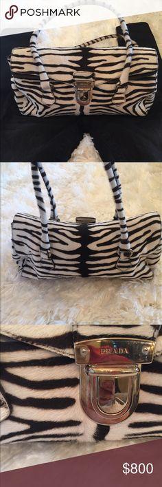 Selling this Prada authentic zebra purse on Poshmark! My username is: noramoore1. #shopmycloset #poshmark #fashion #shopping #style #forsale #Prada #Handbags