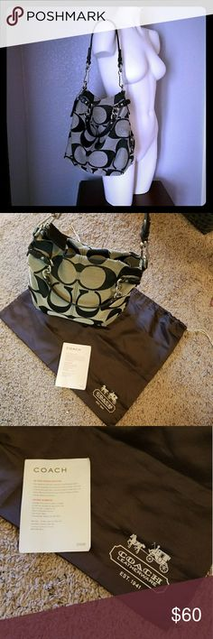 Authentic Coach Signature Hobo Bag Coach hobo with dust bag. Signature tan and brown Coach pattern with brass hardware. Interior with pockets is in great condition. Lightly noticeable wear towards the top as seen in photos. Coach Bags Hobos