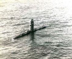 Nope it's not a submarine. It's a B-29 Superfortress bomber about to sink after being ditched north of Guam Mariana Islands 15 May 1945. She was damaged by flak over Nagoya Japan.