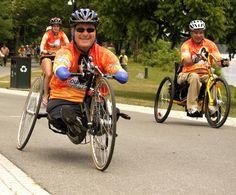 John Robinson, a congenital quad amputee and his business partner Doug Hamlin, a paraplegic, finish a two-week, journey along the Erie Canal. (Mike McMahon - The Record) Erie Canal, Quad, Bicycle, Journey, Business, Fall, Autumn, Bike, Bicycle Kick