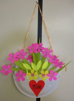 Paper plate flower basket for spring paper plate craft activities you can browse through our mothers day crafts archives here to find inspiring and simple ideas mightylinksfo