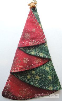Folded Fabric Christmas Tree Ornament — The Inquiring Quilter. This wonderful image collections about Folded Fabric Christmas Tree Ornament — The Inquiring Christmas Tree Napkins, Fabric Christmas Ornaments, Christmas Sewing, Handmade Christmas, Christmas Diy, Handmade Ornaments, Folded Fabric Ornaments, Quilted Ornaments, Christmas Lights