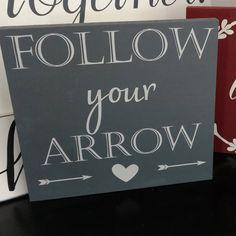 Follow your arrow wood sign