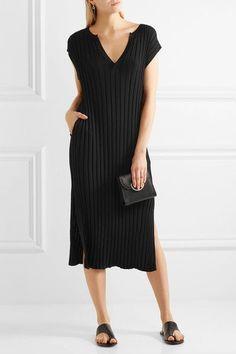Black stretch-knit Slips on 65% viscose, 35% nylon Hand wash Imported