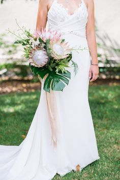 king protea and palm bridal bouquet | Photography: Taylor Abeel Photography