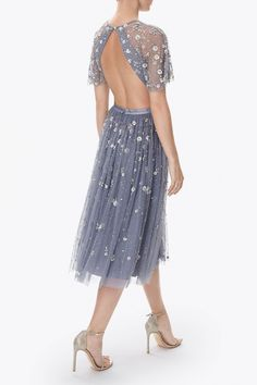 A signature style for Needle & Thread, the backless Comet Dress features all-over embellishment of iridescent sequins and silver cut beading. This embellished tulle midi length dress has a pretty sleeve detail and the vintage blue shade keeps it fresh and playful.