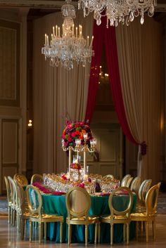 Special event decor featuring vibrant gold, teal and fuchsia colors and beautiful floral decor with gold candelabras. Pink Wedding Decorations, Centerpiece Decorations, Teal And Grey Wedding, Floral Wedding, Gold Color Palettes, Moroccan Theme, Strictly Weddings, Wedding Styles, Wedding Ideas