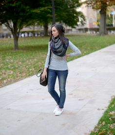 Wellesley & King   Every girl style on a budget. Click to see more fall outfit inspiration like this striped tee, plaid blanket scarf, distressed skinny jeans, converse sneakers, and leather satchel.