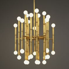 lovely bamboo lamp jonathan adler designed for robert abbey fine lighting. with 30 lights and an elegant brass finish it's quite a stunner. available through robert abbey. Jonathan Adler, Bamboo Light, Light In, Bamboo Lamps, Bamboo Art, Faux Bamboo, Bamboo Garden, White Light, Linear Chandelier