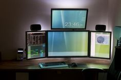 amazing computer station setup four monitors two portrail two landscape