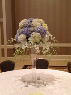 Soft purple and ivory hydrangeas with cascades of ivory dendrobium orchids