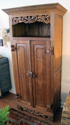Armoire with an open top display shelf made from salvaged teak window shutters and other pieces of reclaimed old growth teak.  From Impact Imports - Boise & Philadelphia