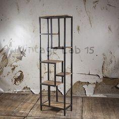 Deze open industriële kast heeft een vintage karakter en kan gebruikt worden als room divider of muurkast. Door zijn open uiterlijk, aparte design en gebruik van ijzer en mango hout krijgt de kast een eigen identiteit. De combinatie van mangohout en Decor, Industrial Furniture, Decor Design, Japanese Interior, Loft Design, Ladder Decor, Vintage Shelf, Metal Furniture, Wood And Metal Shelves