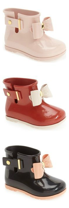 Crushing on these Mini Melissa rain boots for the little one. A darling, oversized bow lends a playful touch to these essential shoes in pink, red and black.