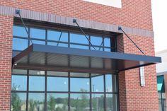 MASA Architectural Canopies: The leader in canopies for storefronts, extruded aluminum canopy, aluminum frame awnings and custom canopy systems, outdoor & metal awnings. Awning Roof, Metal Awning, Awning Canopy, Window Awnings, Metal Roof, Mall Facade, Shop Facade, Metal Door Canopy, Fabric Awning