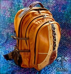 Mama Medicina. Beautiful hand made unique premium leather Backpack. Festival, travel, play, and social ready. Exotic crafted leathers.