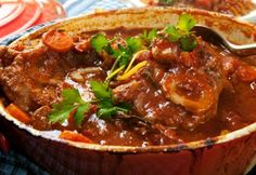 Osso buco is a fancy name for a rich and hearty Italian stew made with veal shanks tomatoes wine and fresh herbs. Here's how you can make osso buco at home. Slow Cooker Soup, Slow Cooker Recipes, Meat Recipes, Cooking Recipes, Recipes Dinner, Comfort Foods, Beef Shank Recipe, Risotto Milanese, Slow Cooked Beef