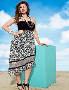 The modern asymmetric cut and sassy mixed print motif put a new perspective on this sexy tube dress. Dare to bare sexy shoulders in this spicy number, featuring a smocked bodice and floating chiffon skirt. Optional, adjustable straps change up the look to match your mood, with adhesive strips at the top keep the fit secure. Lined skirt. lanebryant.com