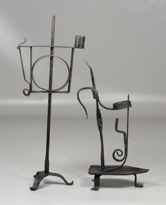"Two American wrought iron adjustable candle holders, 18th/9th c, tallest 18"" high"