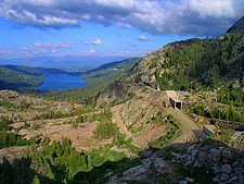 Donner Pass (el. 7,056 ft) is a mountain pass in the northern Sierra Nevada, located above Donner Lake about nine miles (14 km) west of Truckee, California.