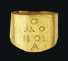 A BYZANTINE GOLD MARRIAGE RING   CIRCA 4TH-5TH CENTURY A.D.   The broad flat hoop engraved on the widest part with the Greek inscription, 'OMONOIA' (harmony), over four lines  ¾ in. (1.8 cm.) across hoop; ring size M