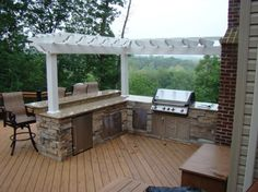"Photo of American Deck & Patio - ""Custom hardscape outdoor kitchen. L shape Granite counter top. Built in Pergola trellis. Outdoor Kitchen Countertops, Outdoor Kitchen Bars, Outdoor Kitchen Design, Outdoor Kitchens, Outdoor Cooking, Outdoor Bar And Grill, Granite Counters, Indoor Outdoor, Outdoor Spaces"